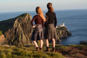 people in a kilt standing at Neist point
